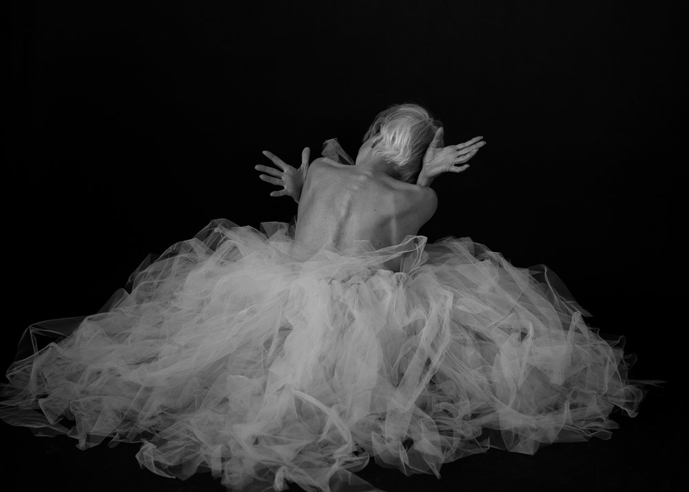Valerie Madonia dances in nest of tulle for fine art photo shoot with photographer Jennifer Koskinen