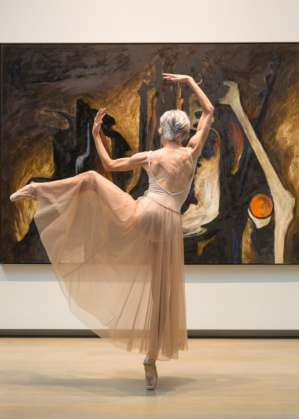 Valerie Madonia dances in photo session at Clyfford Still Museum in Denver with photographer Jennifer Koskinen, Merritt Portrait Studio