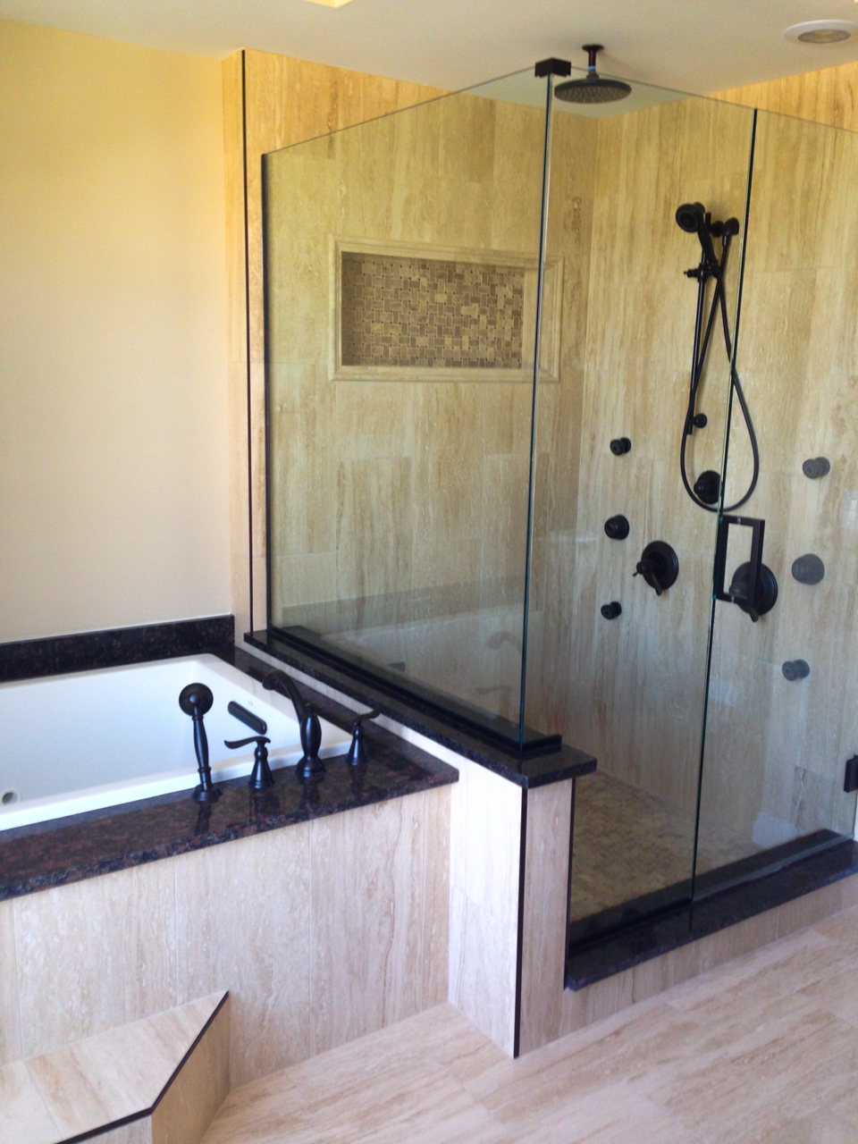 Building relationships one custom home at a time. General Contracting in the Fenton, South Lyon, Novi, Canton, Clarkston, Orion, and other Southwest Michigan areas Custom Shower