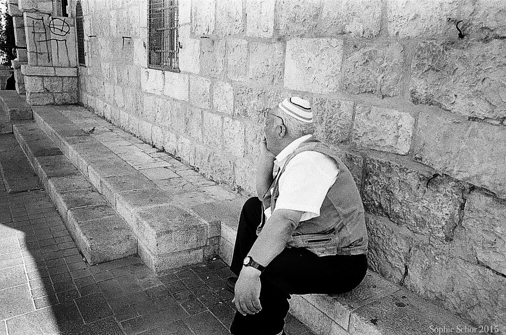 Man sitting on Jaffo St., Jerusalem, June 2014