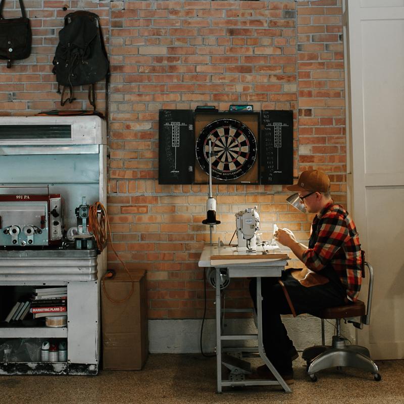 Artisan Ryan Motley in the Olde Stash workshop, Montana, USA.  www.oldestash.com