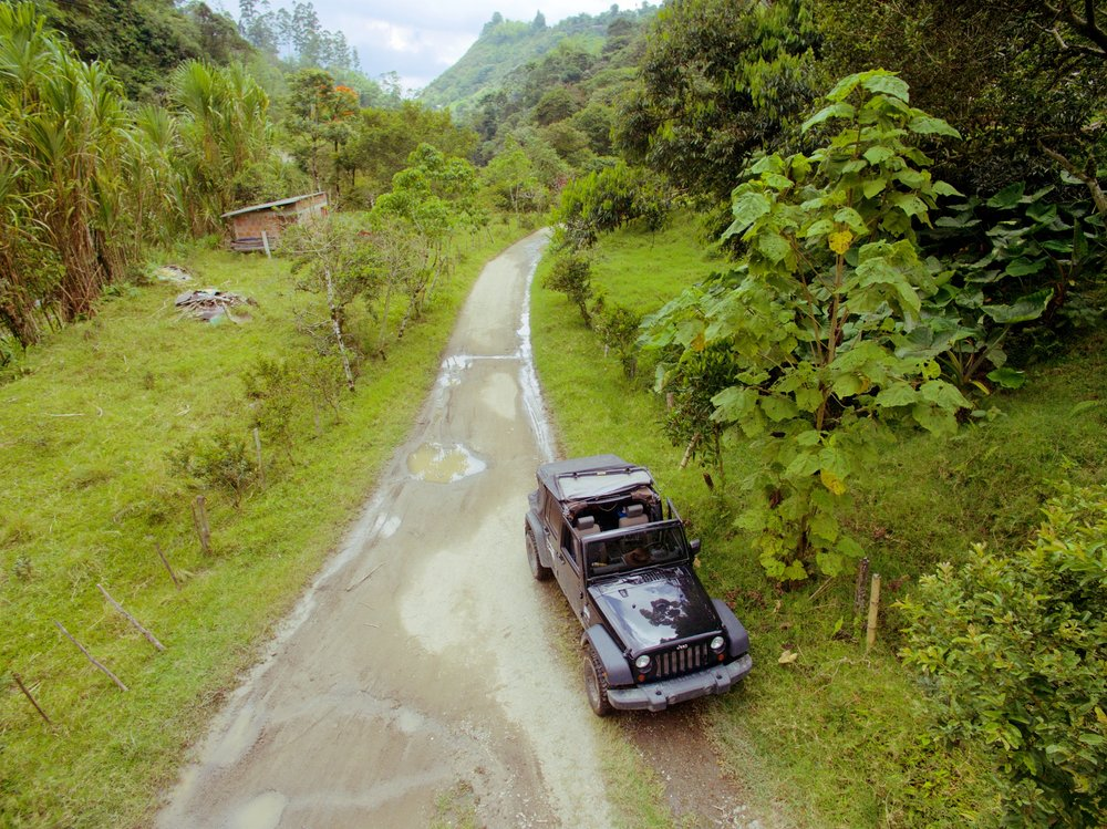 Drone shot of the Jeep near coffee field in Salento, Colombia.