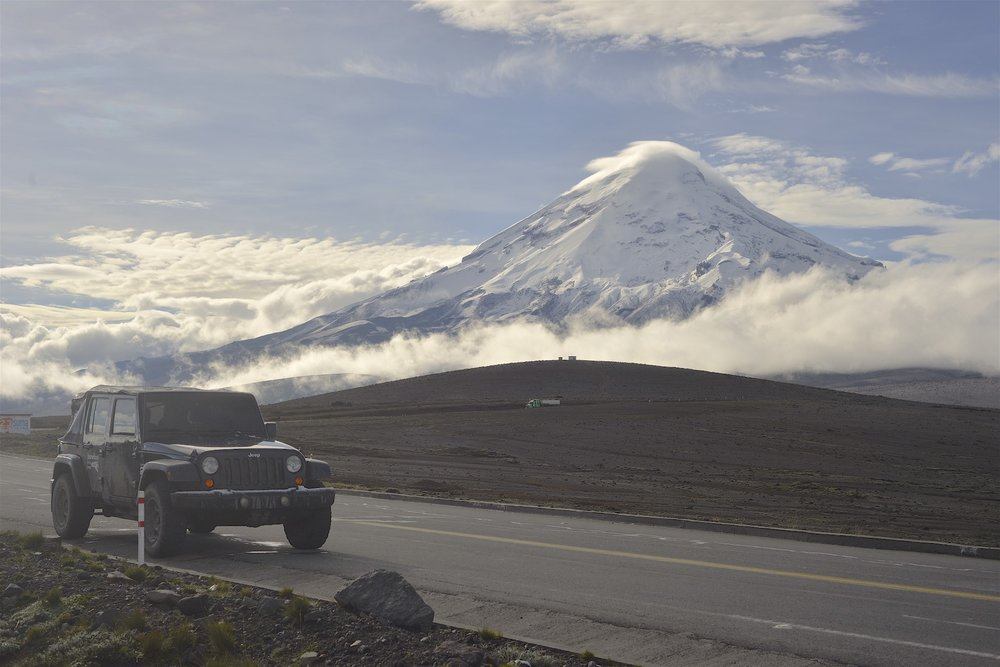 Chimborazo volcano behind the Jeep. 6300 meters.