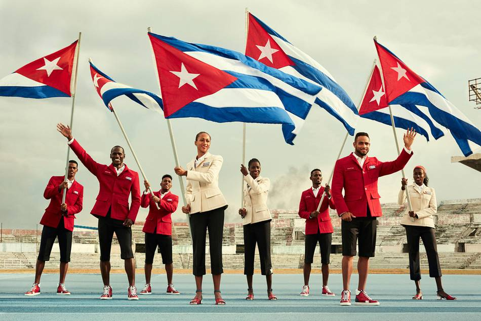 Some of the 100 Cuban athletes waving their national flag