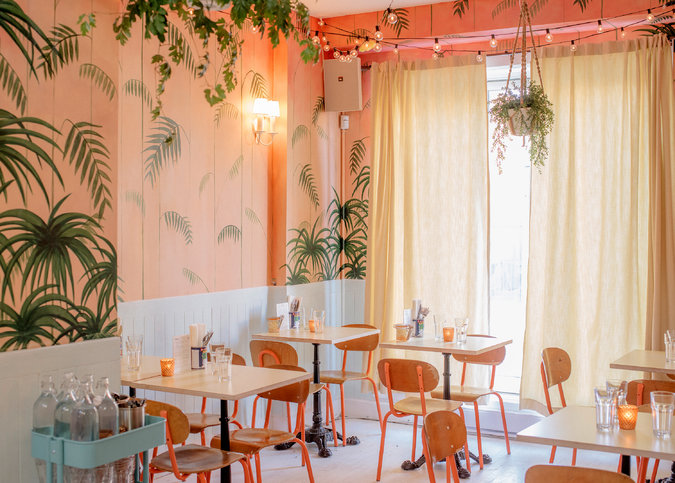 The artist Danielle Worrall painted fronds and flowers onto peach walls at Agrikol. Credit: Alexi Hobbs