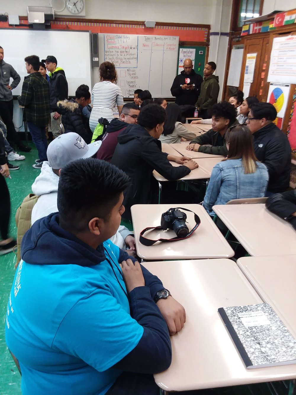 Students meeting and exchanging stories at Explorations Academy