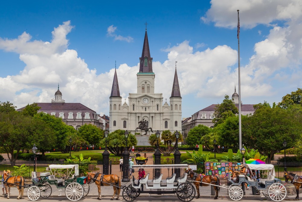 Horse and carriages lined up in front of St. Louis Cathedral in Jackson Square, New Orleans.