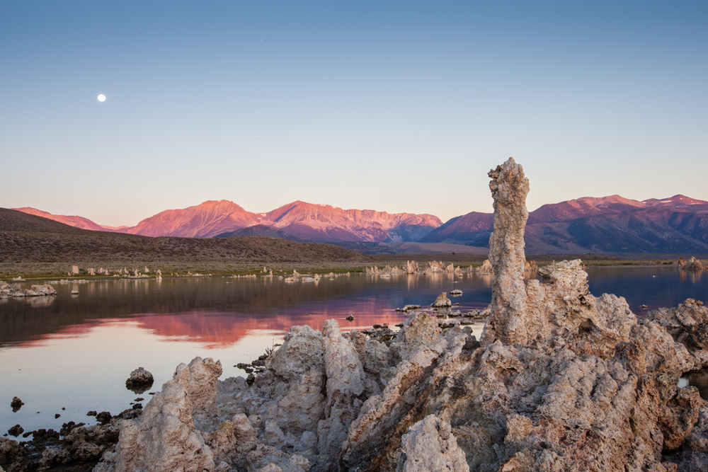 "Sunrise over Mono Lake, one of the saltiest bodies of water in the world.  The ""tufa"" are actually limestone deposits that ended up above water after the lake had been partially drained in the past."