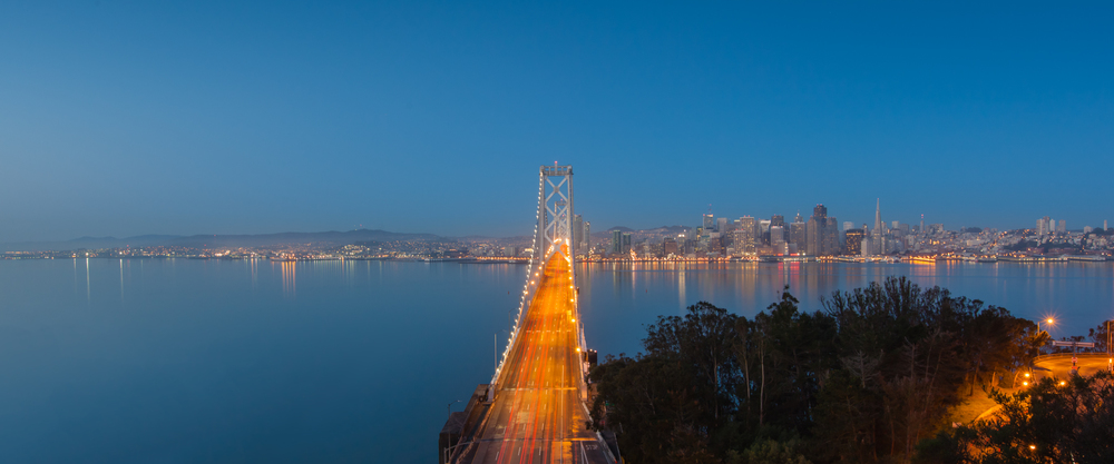 Looking into the city from across the Bay Bridge at sunrise during the blue hour.