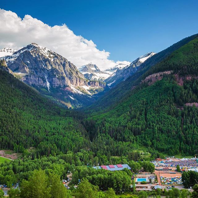 Road Trip Day 34: A latergram of our amazing view in #Telluride at #TellurideBluegrass this year. You could hear the music from here! You can see the crowd for the festival in the bottom right of the picture #roadtrip