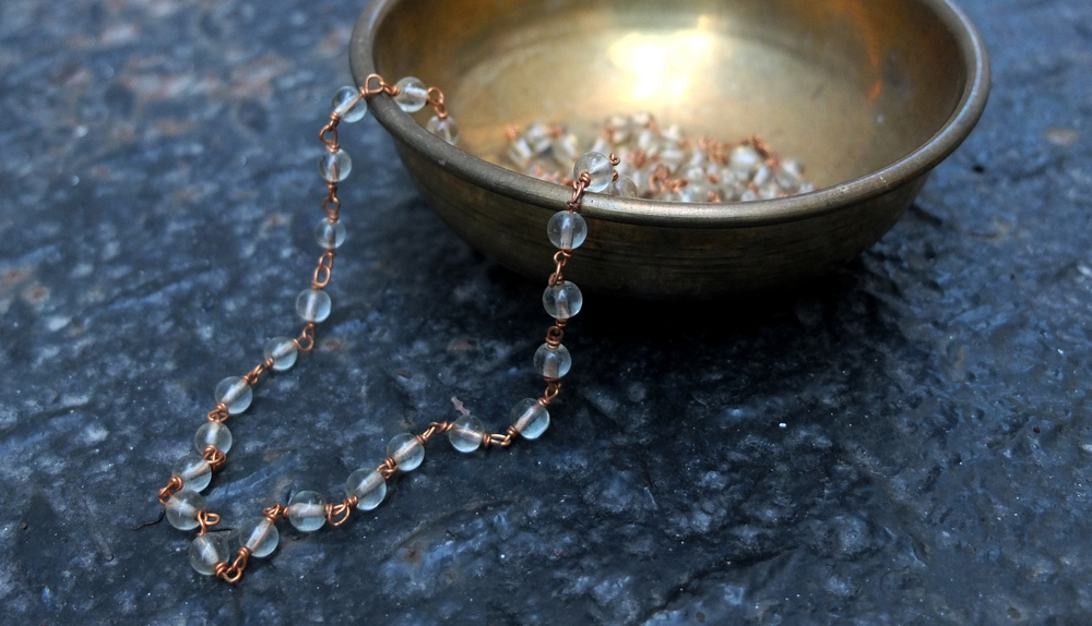 CLEAR BEAD STRAND IN BOWL.jpg