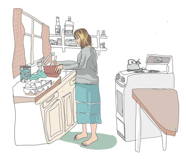 Julie cooking breakfast in cabin kitchen