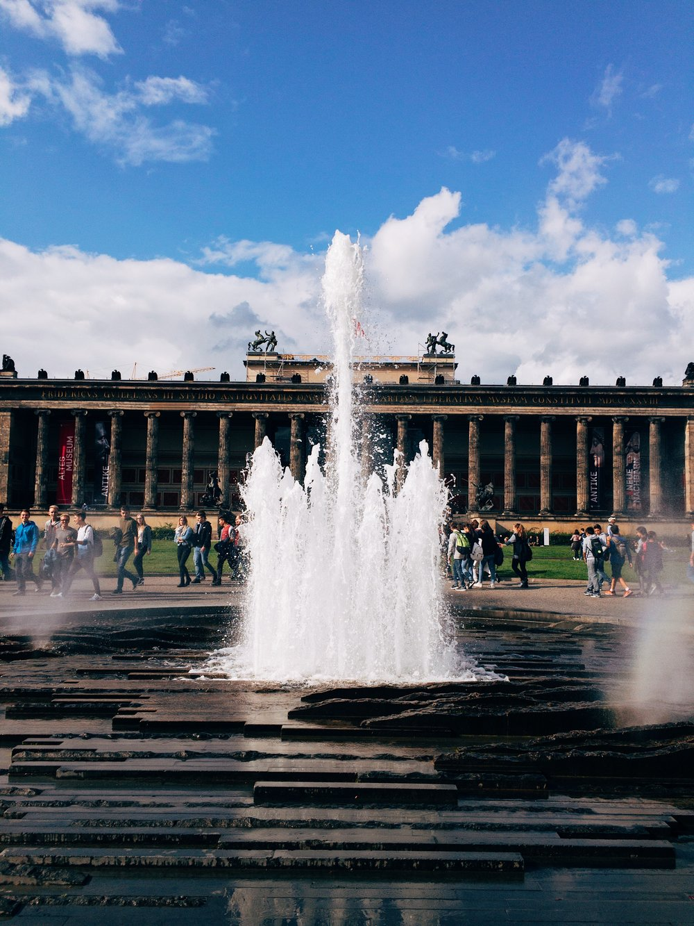 fountain by berliner dom with altes museum in the background