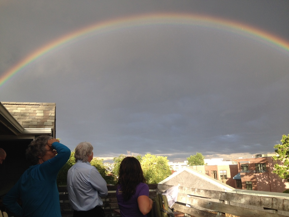 BWS Novelists break to take in a double rainbow from our rooftop deck