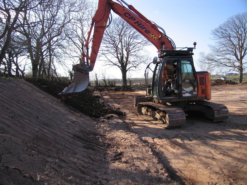 Digger work while landscaping