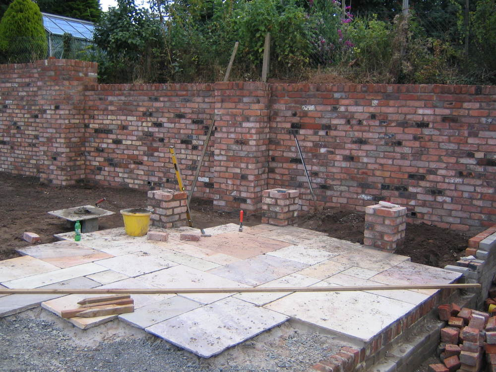 sandstone paving and reclaimed bricks in garden belfast
