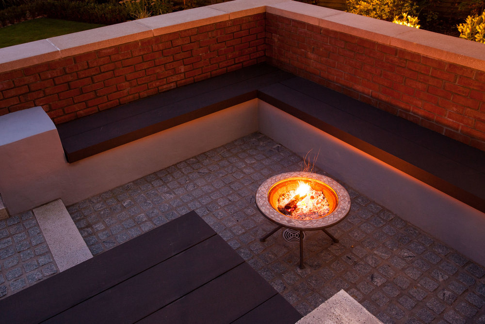 This garden was designed using 3d garden design and built by dunn landscapes. Composite decking made by Dura composites supplied by Ridgeway belfast was used for the seating. Granite sett paving was installed supplied by ced stone and grouted using Larsen FJM. Led garden lighting was used and well as some uplighting. A garden firepit is also i frame being used for relaxing in the garden.
