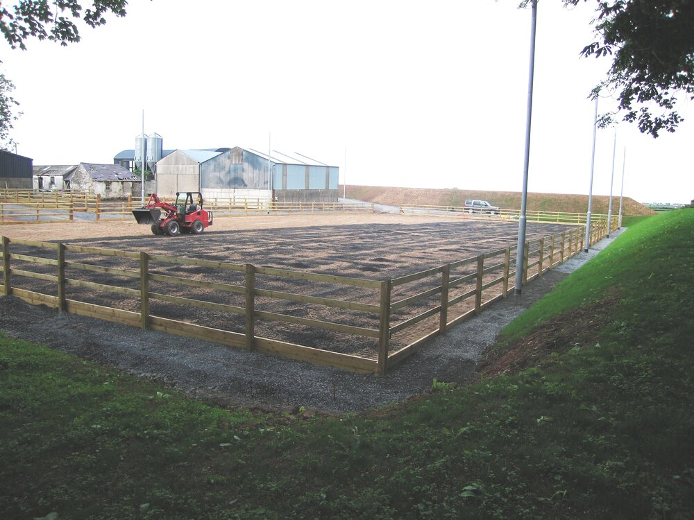 equestrian rubber for sandschool with fencing and landscaping uk dunnlandscapes