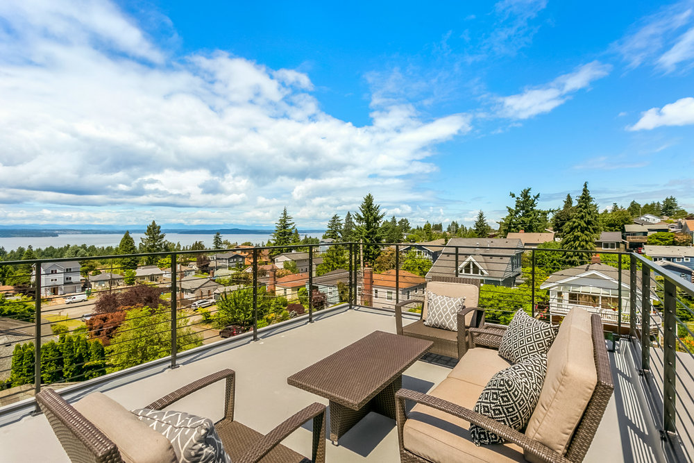 Rooftop deck with spectacular views of the Puget Sound, Blake Island, and the Olympic Mountains.