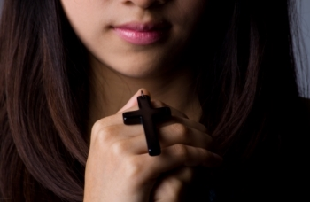 woman holding cross.jpg