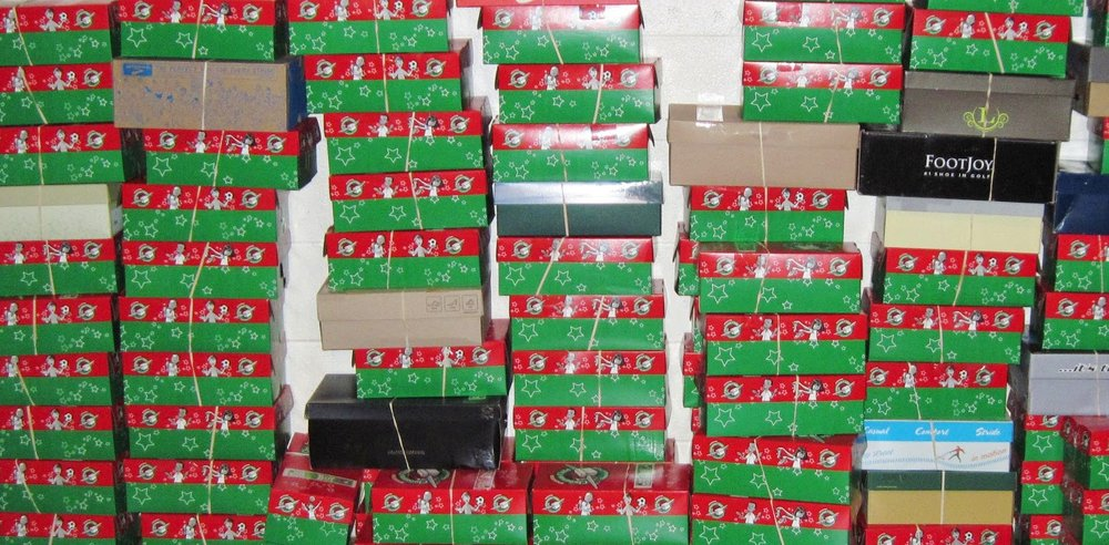stacks of operation christmas child boxes.JPG