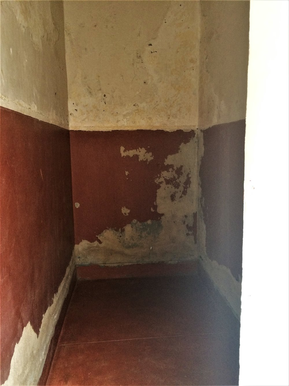 The men's solitary cells, which are no more than 10 ' by 4'.