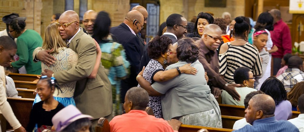 Black church hugging.jpg