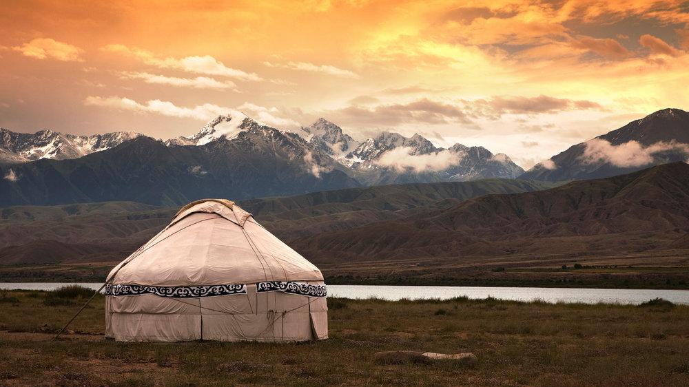 Mongolia--yurt with gorgesou mountains behind.jpg