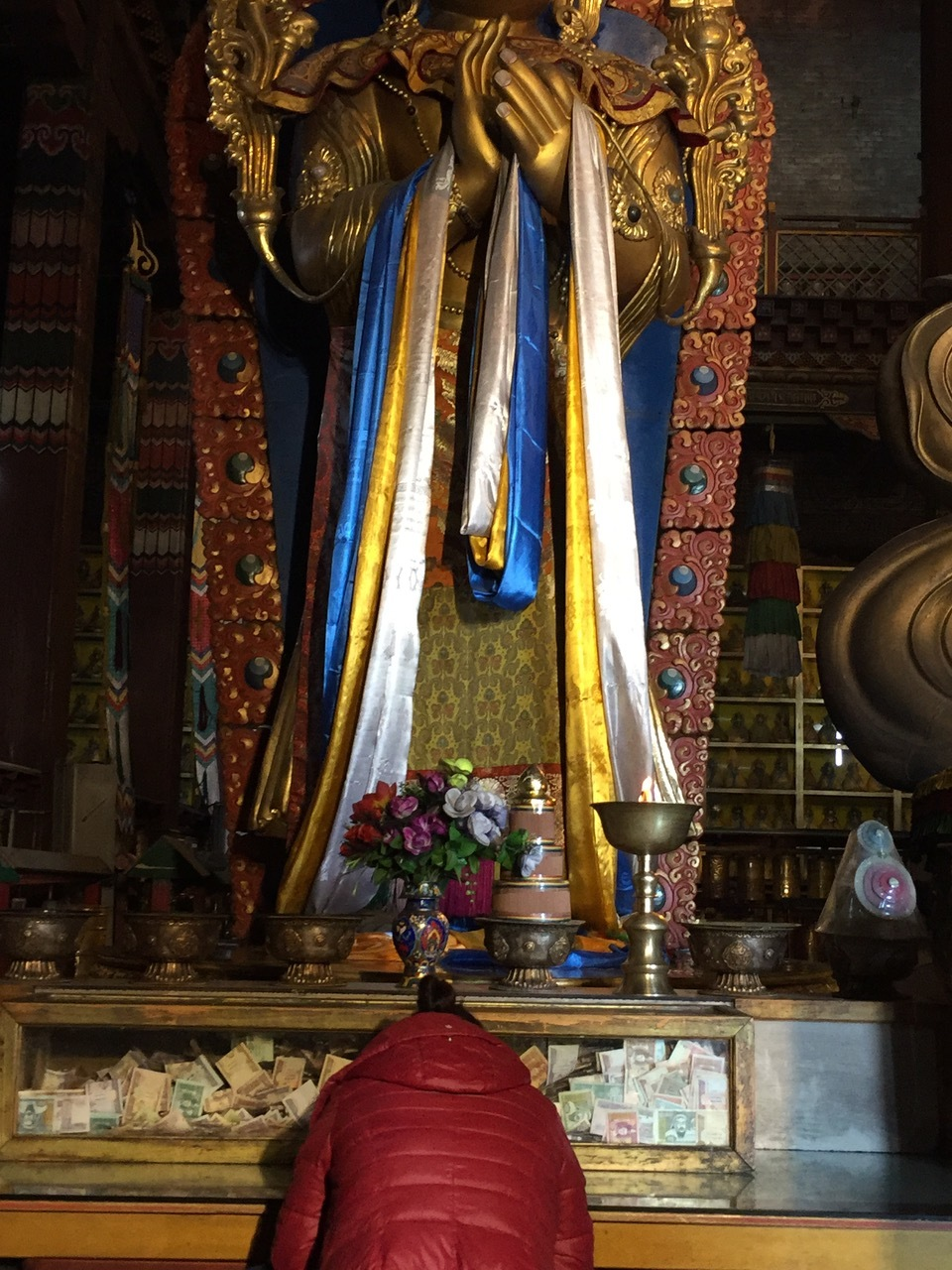 Mongolia--woman bowing before Buddha.jpeg