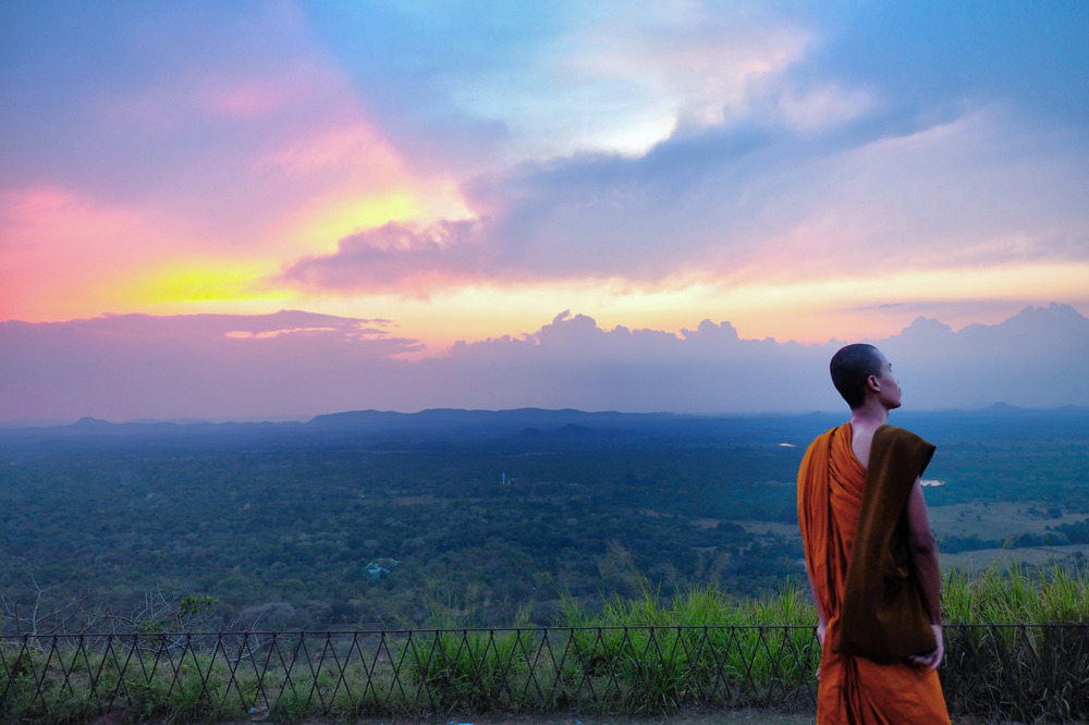 The sun had set and time got the better of us, my friend and I were the only ones remaining at the top of Sigiriya.  The last remaining moments of light we came across 4 monks that we had befriended earlier. There was a surreal moment makin g our way back down the 1202 steps in darkness, being guided by monks illuminating our path with the light from their mobiles.  Jumping fences and slightly disorientated we all made it safely to the bottom. We thanked our new friends and said goodbye smiling, one monk took a liking to my friend  Moe  and had even asked for his number .         The perfect ending to a perfect day.           Olympus OM-D E-M1 + 12-40mm f2.8