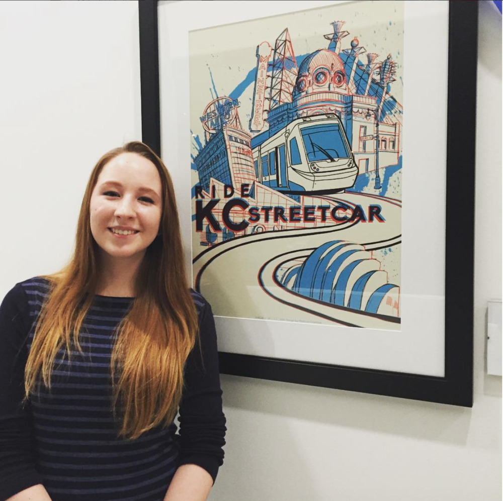 1st place winner Madison Crabtree and her KC Streetcar poster that will be used for marketing and promotional materials for the KC Streetcar.
