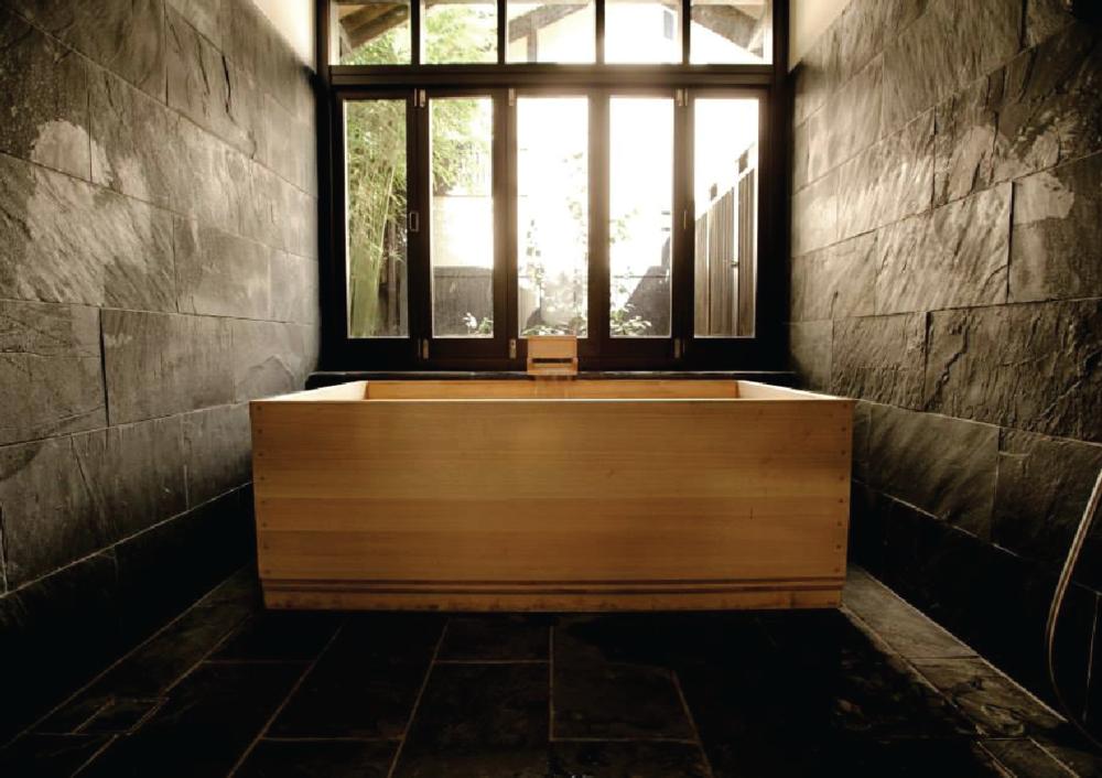 ryokan gojyuan - two storey sandstone terrace transformed into traditional style Japanese inn.