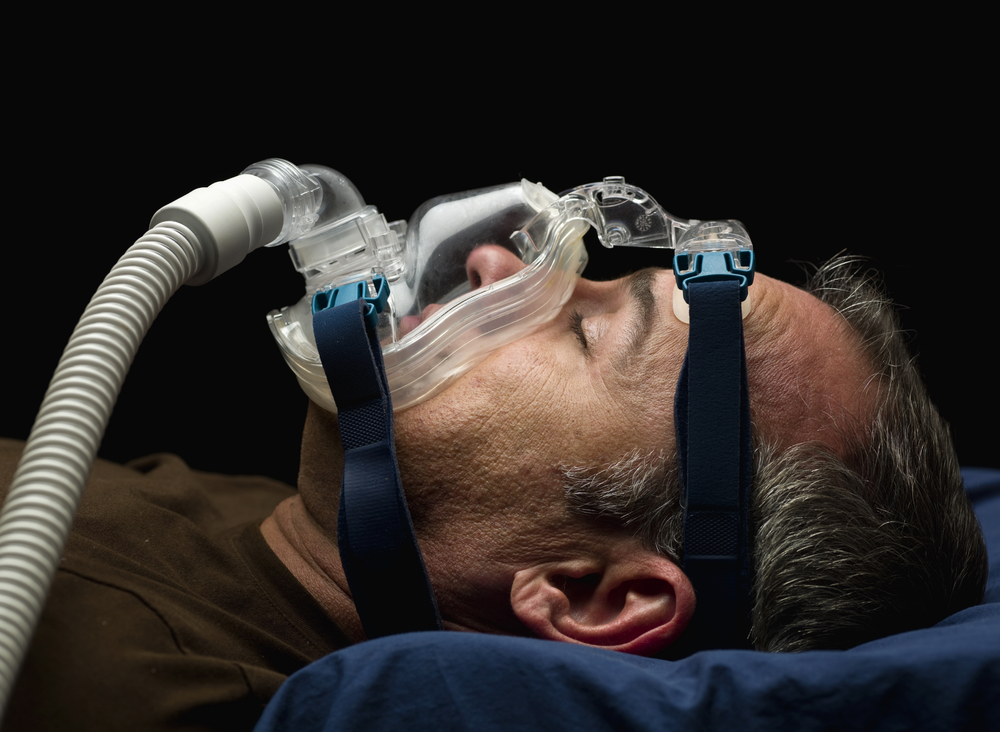 Traditional CPAP mask - cords, hoses, straps, masks.