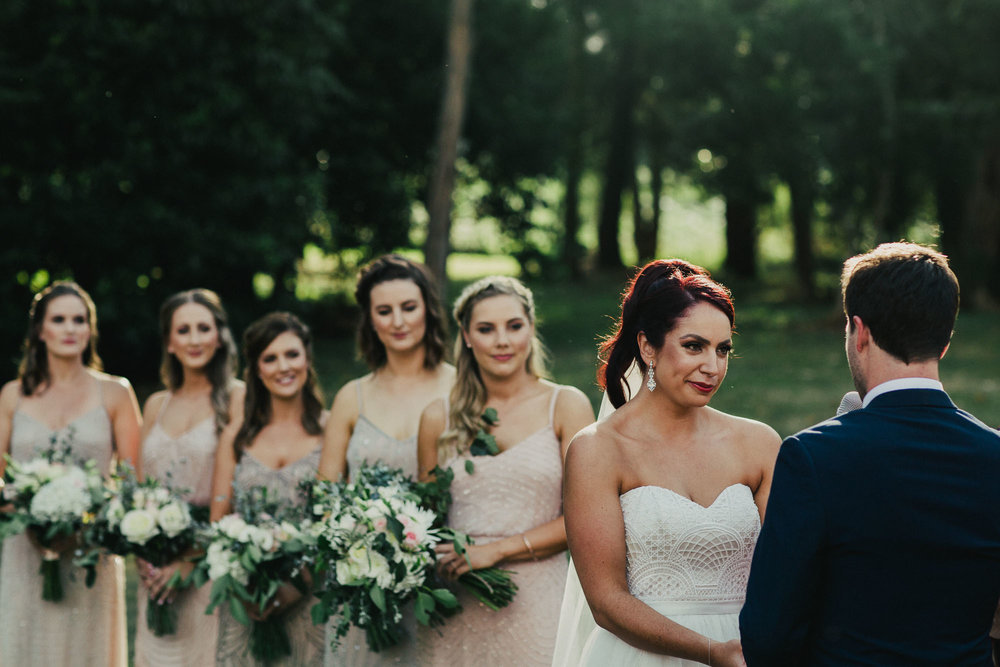 Bianca's 5 bridesmaids wore champagne coloured gowns with intricate beaded patterns.