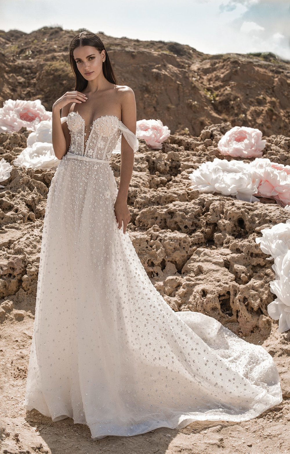 NOELLE Corseted off shoulder dropped sleeve ball gown with ombré 3D petals