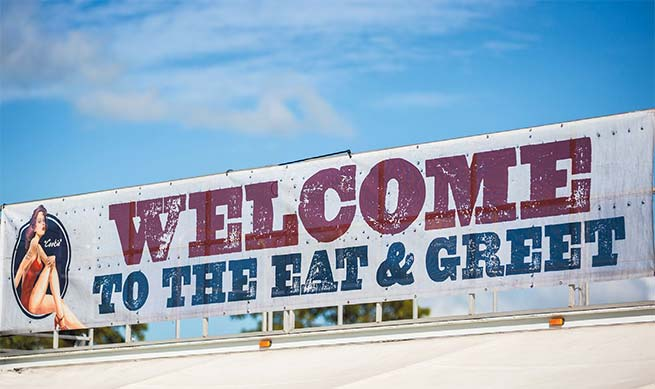 Eat and Greet sign over tent
