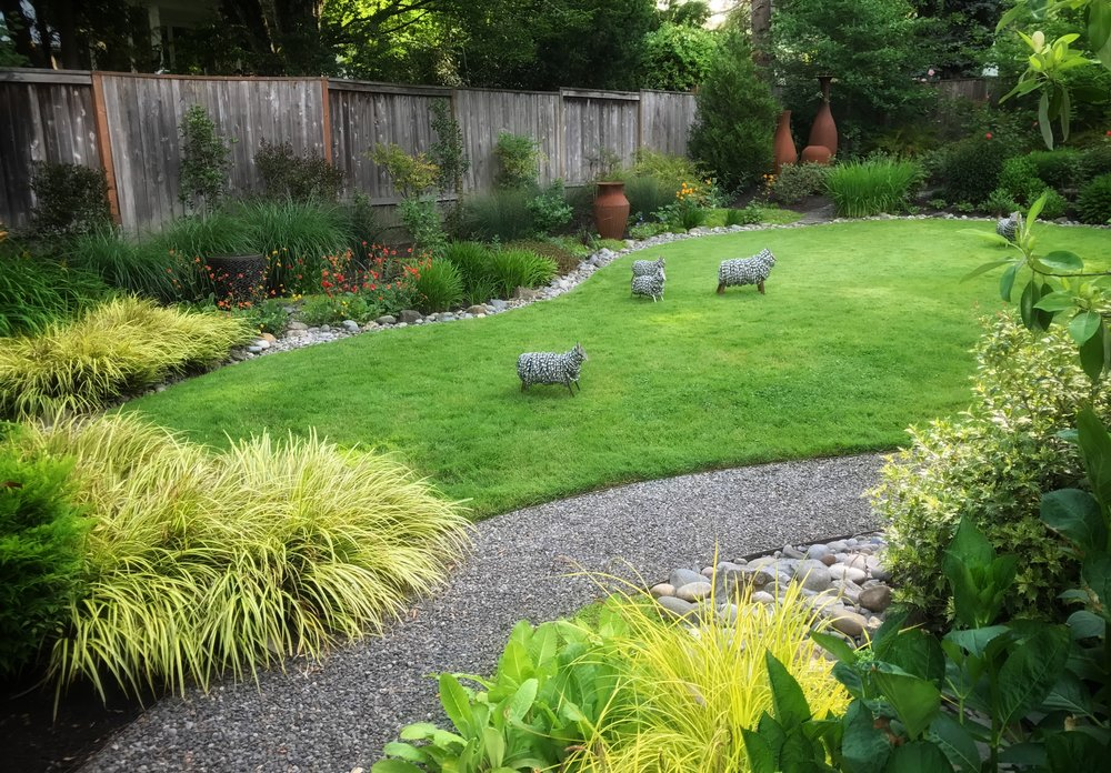 Marta Farris  ' sheep sculptures made Terri's Garden quite bucolic.
