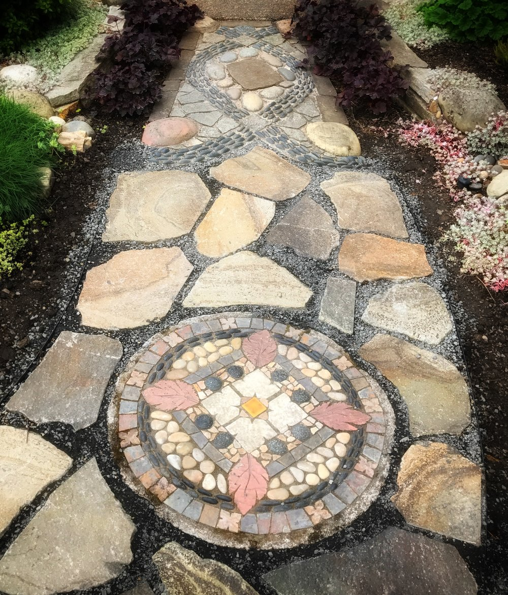 Marcia Peck mosaics in the paths, everywhere. They bring a feel of luxury.