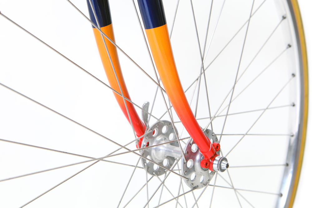 Eroica Steel lugged forks painted in metalic midnight blue with pearl orange and cherry red fades