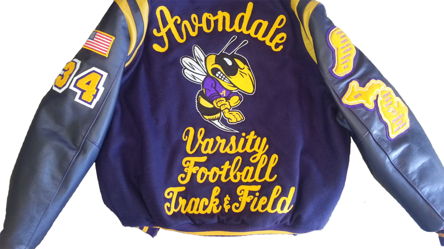 AvondaleFootballTrackField-ChenilleChainstichLetteringJacket-SewPatchesOnSleeves-MensYellowJacket-wb.png