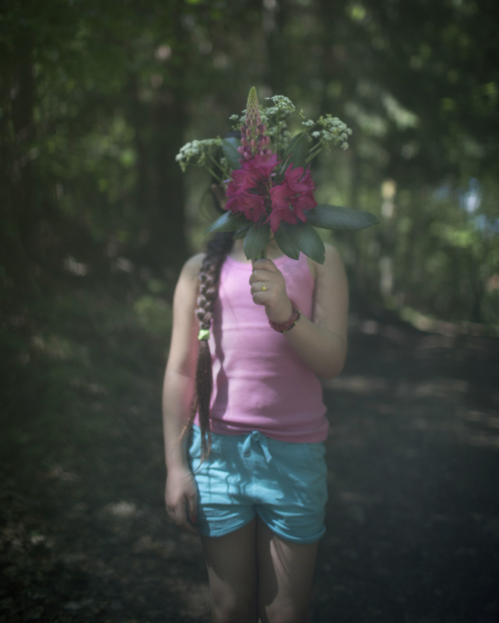 Wild flowers grow everywhere here. The enchanting forest environment invites the children and their mothers to arrange beautiful bouquets together.