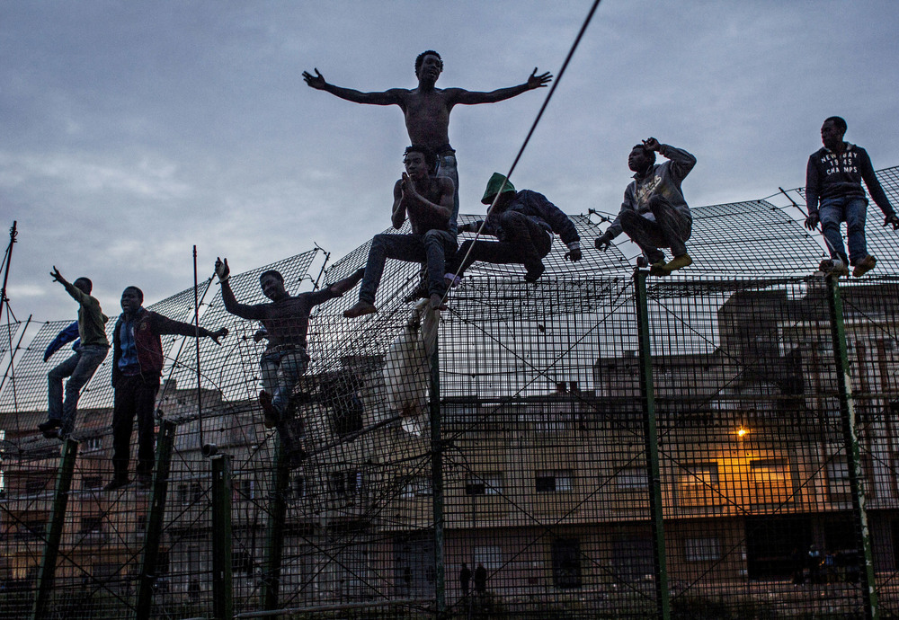Young migrants from Ivory Coast beg for clemency from the police who have just illegally deported them back to Morocco. EU law bars summary deportations and requires members to allow anyone who steps foot on their territory to apply for political asylum.