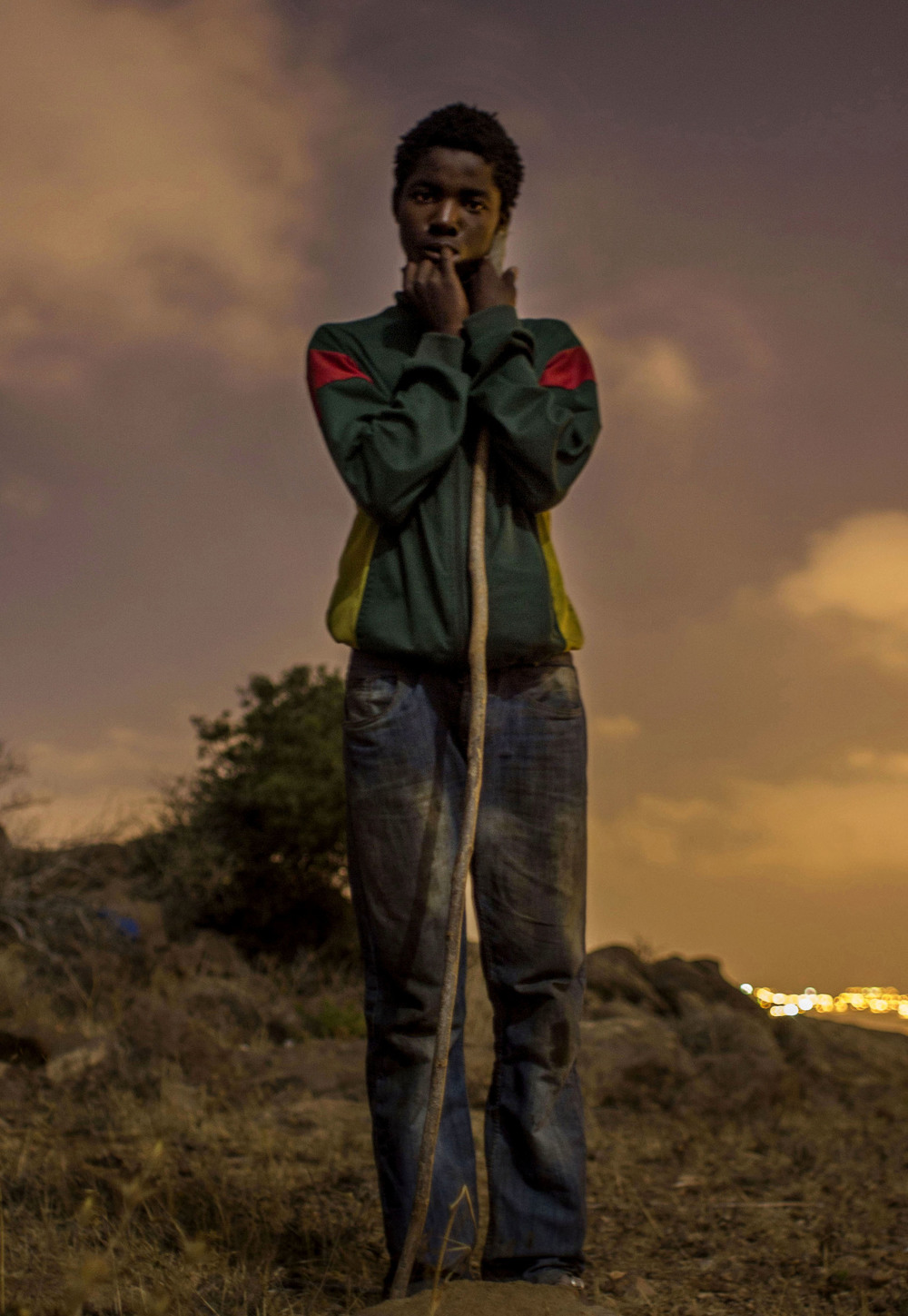 A child migrant from Cameroon hides in the Gurugú Mountains while he waits to jump the border fence into the Spanish port city of Melilla.