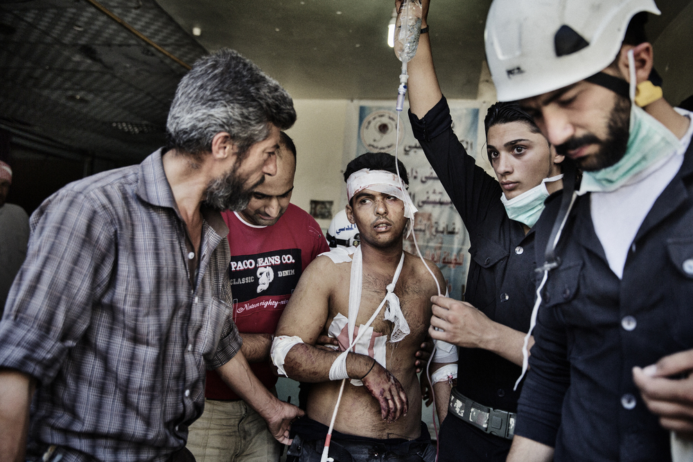 A critically injured member of the Civil Defense Team is treated for his shrapnel wounds inside a make-shift hospital. June 22, 2014.