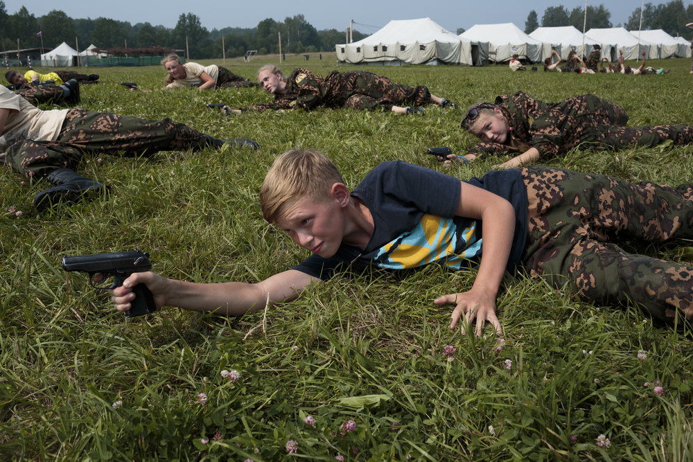 Students train in firearms at the Historical-War Camp, in Borodino, Russia. July 24, 2016. Borodino is famous for a battle fought on September 7, 1812 - the deadliest day of the Napoleonic Wars. They are using air-soft guns for the practice and competition. The camp teaches information about the basic kinds of weapons, bases and firing rules,  sniper rifles and different type of weapons. © Sarah Blesener