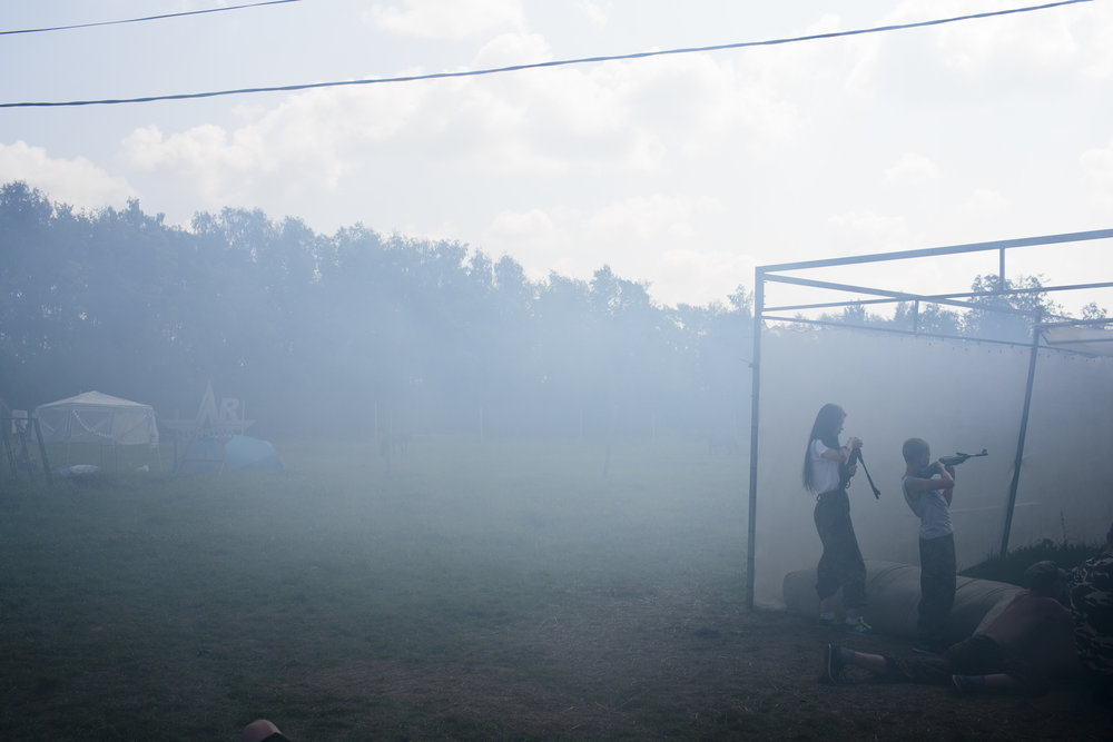 A fake grenade is launched, setting smoke in the atmosphere as students practice a drill with air-soft guns at the Historical-War Camp, in Borodino, Russia. July 29, 2016. They are using air-soft guns for the practice and competition. Borodino is famous for a battle fought on September 7, 1812 - the deadliest day of the Napoleonic Wars. 350 adolescents are in attendance, ranging in ages from 11 to 16, and lasts throughout the summer. © Sarah Blesener
