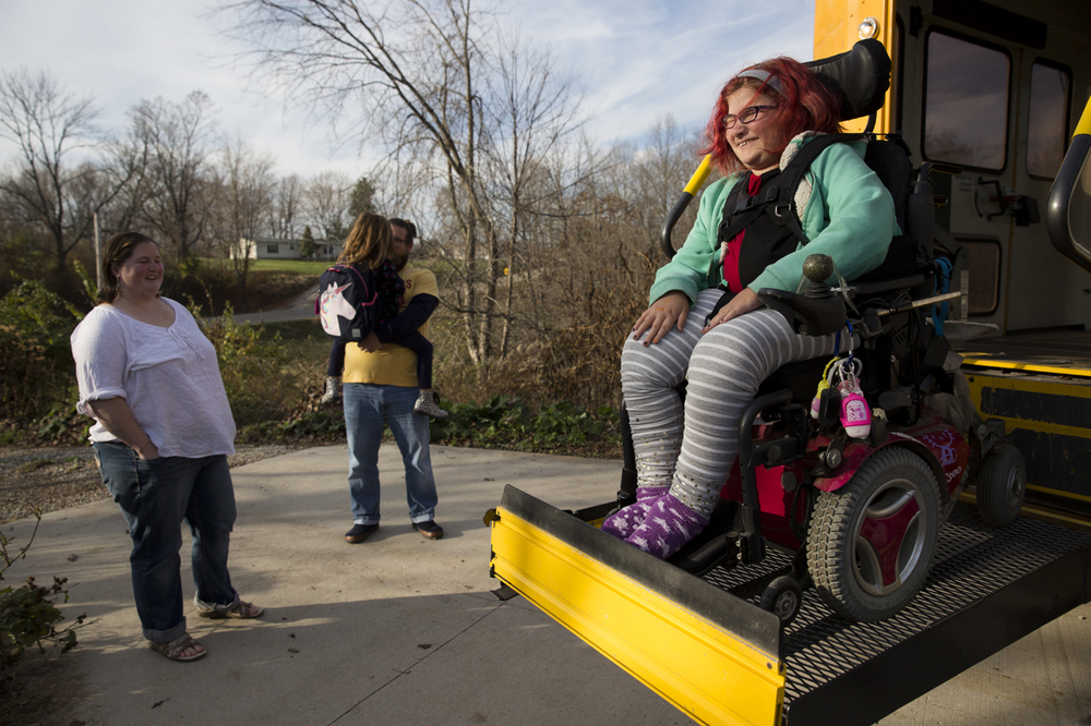 Adyn gets off the bus after school on November 11, 2015.  11-year-old Adyn Bucher is just like any other sixth grader. She loves Harry Potter, hates math, and is a master of sass and sarcasm. The only difference is that Adyn has spent most of her life in a wheelchair. Adyn was diagnosed with Spinal Muscular Atrophy type II when she was 18 months old. SMA, a genetic disorder that reduces muscle control and limits mobility, is relatively rare, affecting only about 1 in 6,000 people. Despite Adyn's physical limitations, with the help of her parents and health aides she lives a normal life and experiences the same joys and issues as any other preteen.