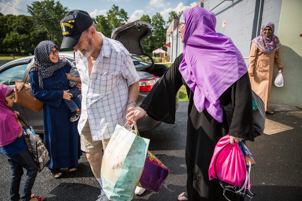 "Kareema Taghi, right, talks to Madiha, left, as she leaves the Masjid with her father, Dave. Kareema grew up as a ""military brat,"" and spent a lot of time church-hopping before finding Islam in her early 30s. The daily lives of Muslim women around Harrisburg, Pennsylvania, are focused on community, family, children and each other. Their experiences are diverse, but their tight-knit community is supportive and inclusive. Many of the women photographed asked to only be identified by their first names because of negative experiences with media."