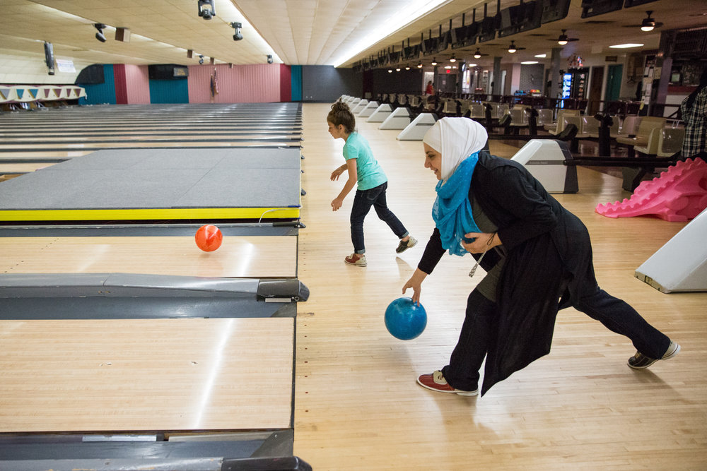 Yara, left, and her mother, Farah, bowl during a party held to welcome new Muslim women in the area at Trindle Bowl in Mechanicsburg.