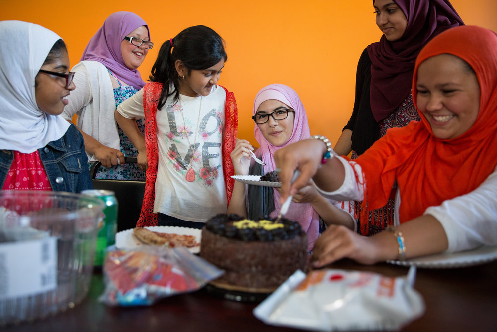 From left to right, Zaineb, Amena, Naira, Aisha, Ramsha and Ayesha eat cake in celebration of Aisha's birthday at Crown Fried Chicken in Mechanicsburg, Pennsylvania, on July 23, 2016.